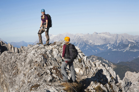 Two female alpinists standing on mountain top, Innsbruck route, Tyrol, Austria LANG_EVOIMAGES