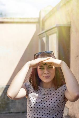 Young woman, hands covering eyes, Osijek, Croatia