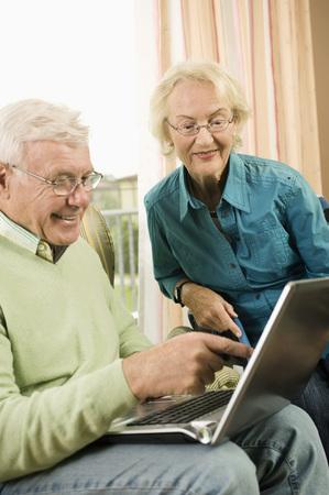 silver surfer: Senior couple using laptop in nursing home, Bavaria, Germany