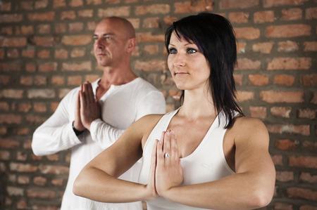 body consciousness: Couple Practising Yoga, Portrait