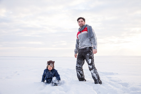 Father and son playing in snow
