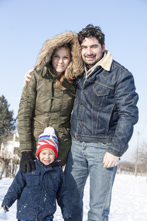 Parents with boy in snowy landscape