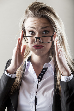 Businesswoman with eyeglasses frowning LANG_EVOIMAGES