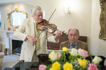 Two senior men playing music together LANG_EVOIMAGES
