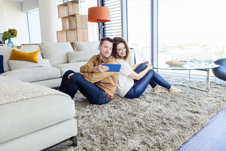 living room window: Couple relaxing in modern apartment