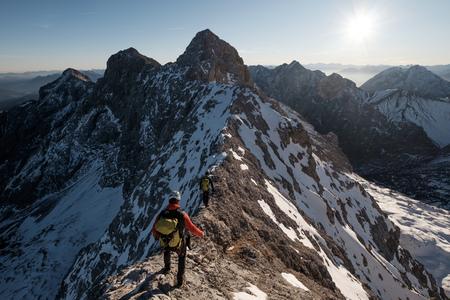 Mountaineer hiking on mountain peak in European Alps LANG_EVOIMAGES