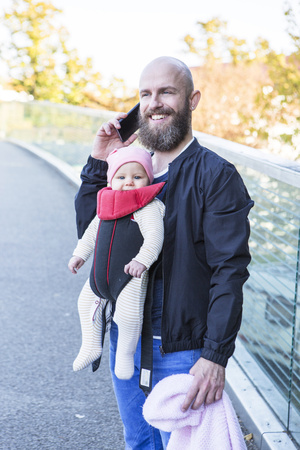 Father with baby girl in baby carrier