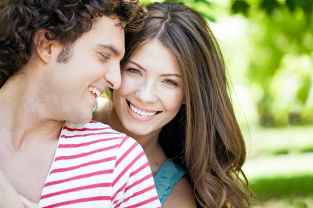 head on shoulder: Close-up of young romantic couple on a sunny day in the park. Stock Photo