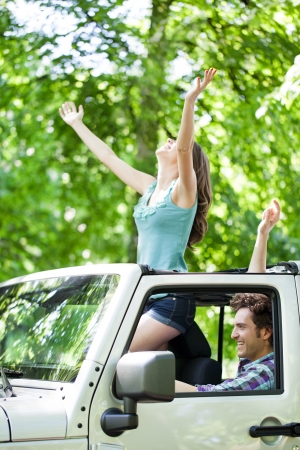 Attractive young romantic couple enjoying in ride through the forest. photo