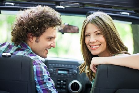 Attractive young romantic couple enjoying in driving through the nature. photo
