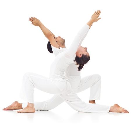 yoga man: Two people doing yoga together. Stock Photo