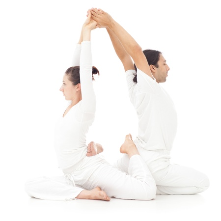 physical activity: Two people doing yoga together. Stock Photo