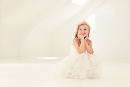 and four of the year: Cute smiling girl in a white dress. Stock Photo