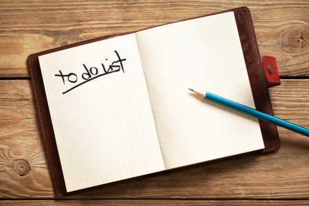 item list: Opened personal organizer with a to do list. Stock Photo
