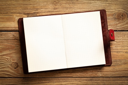 barnwood: Opened personal organizer on a wooden surface.