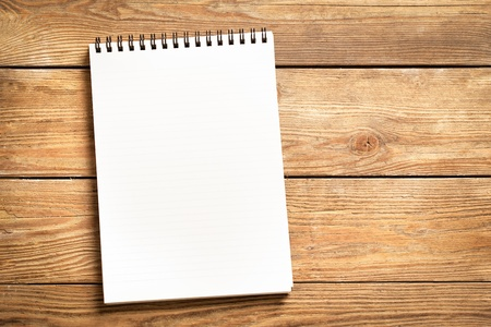Blank notepad on a wooden surface. Stock Photo - 19098976