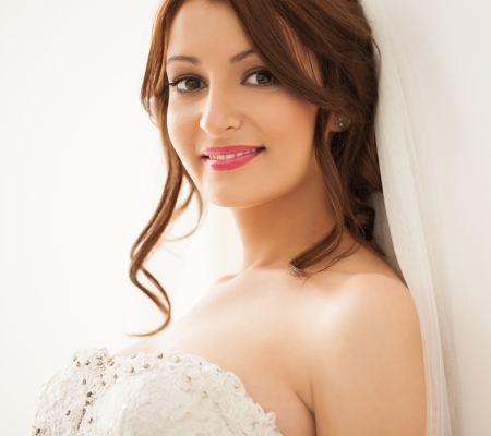 studio photography: Portrait of a beautiful young bride smiling.