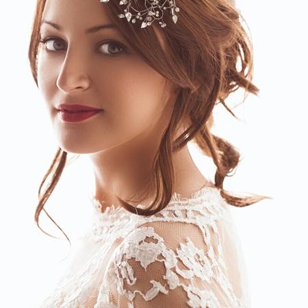 head dress: Portrait of a beautiful bride smiling.