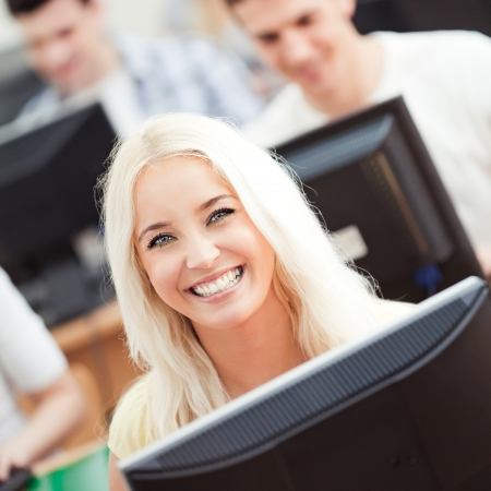 computer science: Portrait of a smiling student in computer science class.