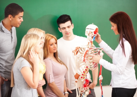 Anatomy teacher and her students in class. photo
