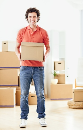 carboard box: A handsome man holding a carboard box in his hands. Stock Photo