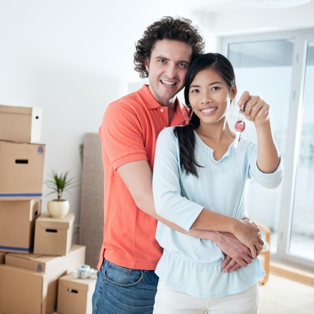 Happy couple moving into a new apartment. photo