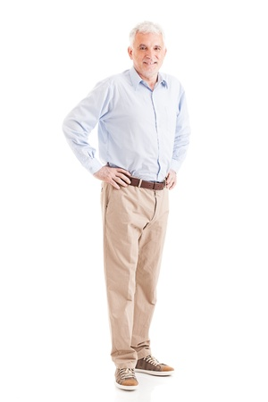 casually dressed: Casually dressed senior man posing with his arms akimbo. Stock Photo