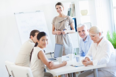 flip chart: Busniess team in a meeting. Stock Photo