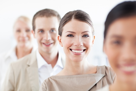 happy business team: Members of a successful business team in close-up.