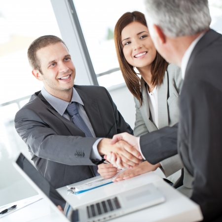 bank manager: A couple after a successful meeting with their financial advisor. Stock Photo