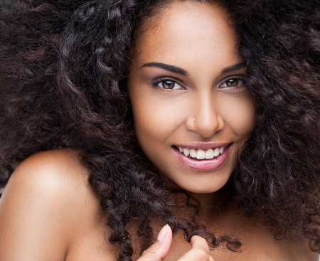 topless women: Portrait of a beautiful young African woman smiling.