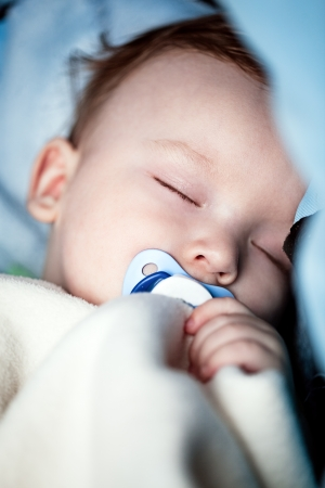 Close-up of an adorable baby sleeping peacefully in bed  photo