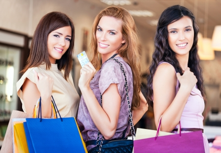 Three good friends enjoying shopping together. photo