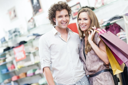 A young happy couple shopping together in a boutique. photo