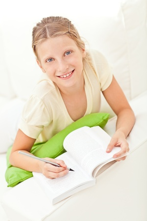 A cute girl studying at home. photo