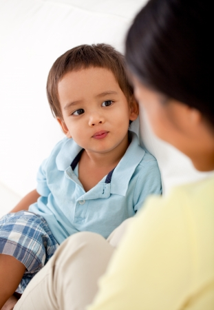 playful behaviour: A mother and her cute son looking at each other. Stock Photo
