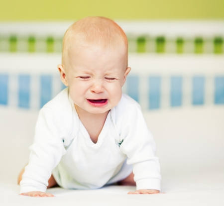 Cute baby boy crying. Stock Photo