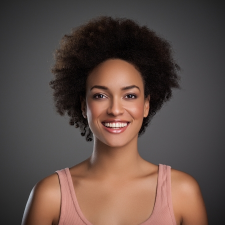 afro woman: Portrait of a beautiful smiling African woman.