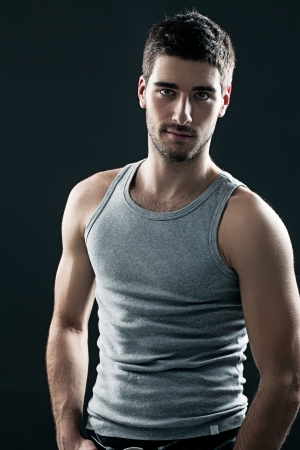 Portrait of a muscular young man wearing a sleeveless top. Stock Photo