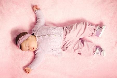 baby nursery: Cute baby girl sleeping tight.