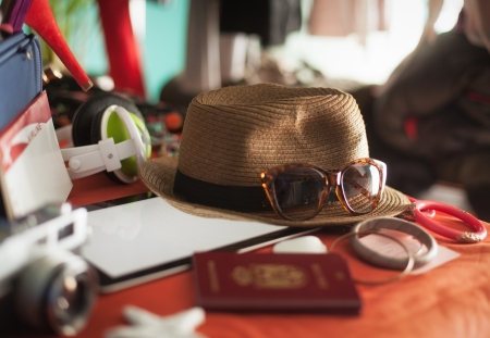 Digital tablet, airline ticket and other accessories ready to be packed for summer holiday  Stock Photo