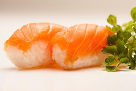 nigiri: Two pieces of salmon nigiri sushi.