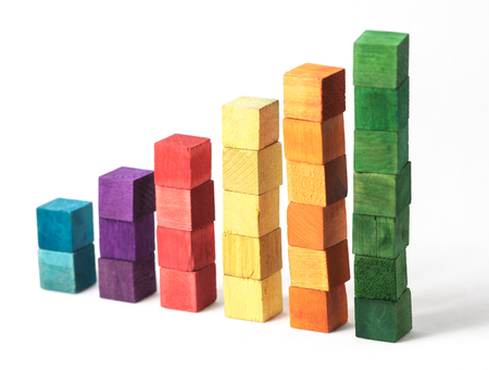 Stacked wooden coloured cubes isolated on white background