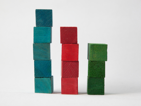 Blue, red and green stacked coloured wooden cubes isolated on white background