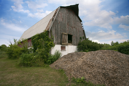 Places Southern Ontario Amherstburg Dilapidated Abandoned Barn cloudy sky scene Stock Photo