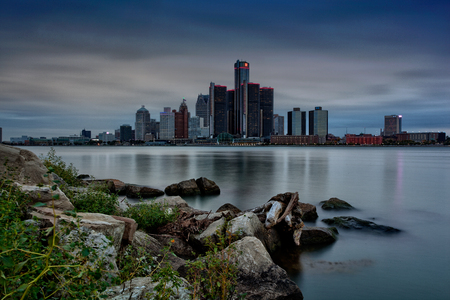 Scenic Windsor, Ontario riverfront view of Detroit, Michigan on a cloudy day
