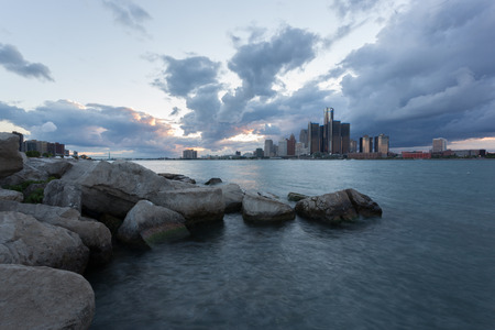 Scenic Windsor, Ontario riverfront view of Detroit, Michigan on an sunny cloudy day