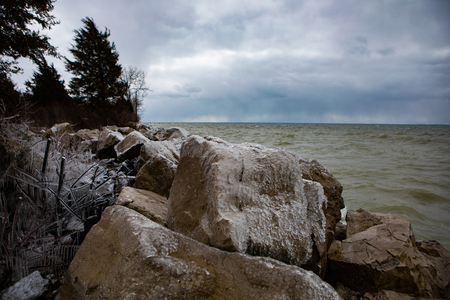 Scenic Landscape Background Rocky Shore Foreboding Weather Icy Boulders in Winter Stock Photo