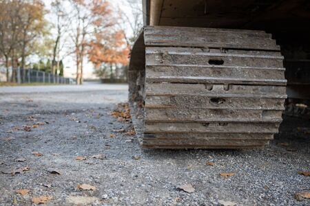 Low Angle Closeup View of Bulldozer Track Grouser Pad and Roller Stock Photo