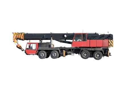 payload: Mobile hydraulic truck crane in transport position isolated on a white background.